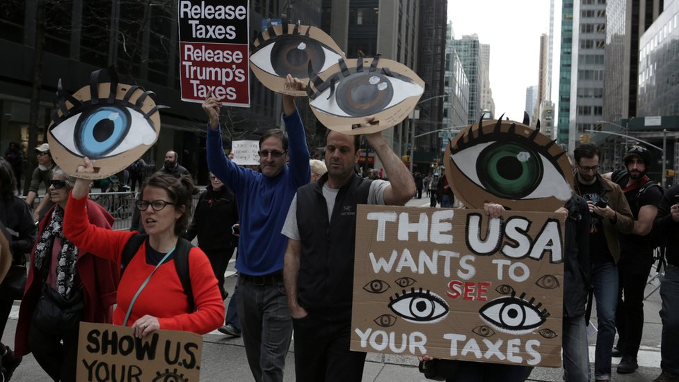 NY 2017 protest with signs about Trump taxes