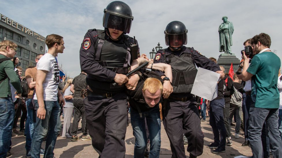 Russian Police forces seen arresting a protester during a demonstration in Moscow's Pushkin Square