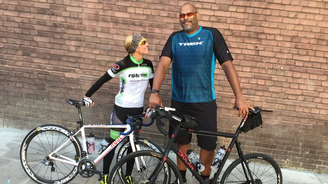 John Amaechi and trainer with their bikes