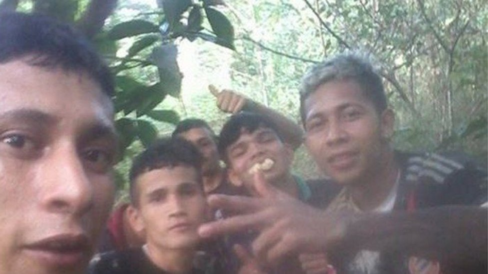 A picture posted on Brayan Bremer's Facebook page shows him with four other men, one of whom is eating fruit