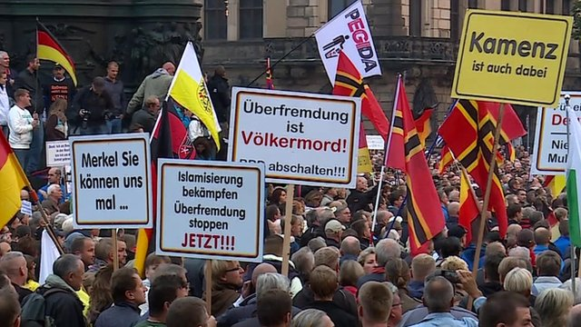 Protesters with flags and banners