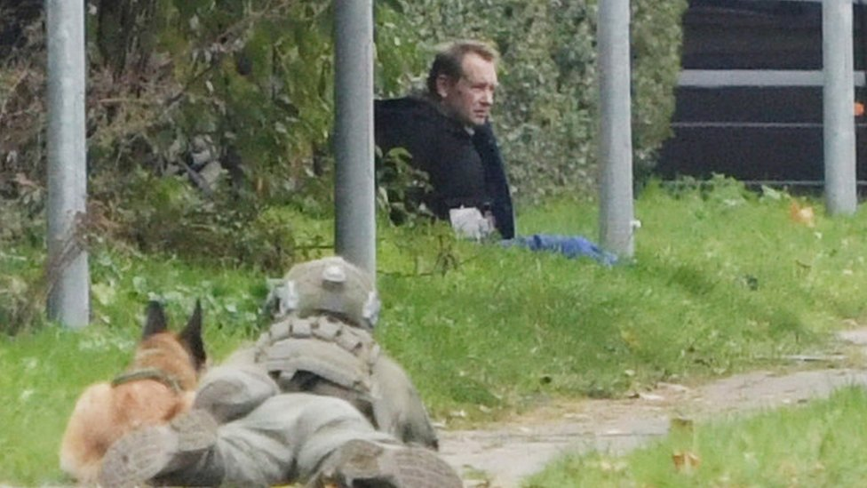 Peter Madsen is seen surrounded by police in Albertslund, Denmark October 20, 2020