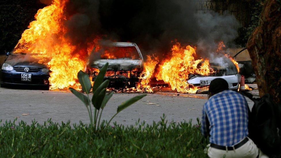 Cars are seen on fire in Nairobi, Kenya