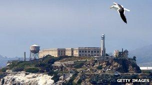 A seagull flies over Alcatraz Federal Penitentiary on Alcatraz Island 2 July 2003