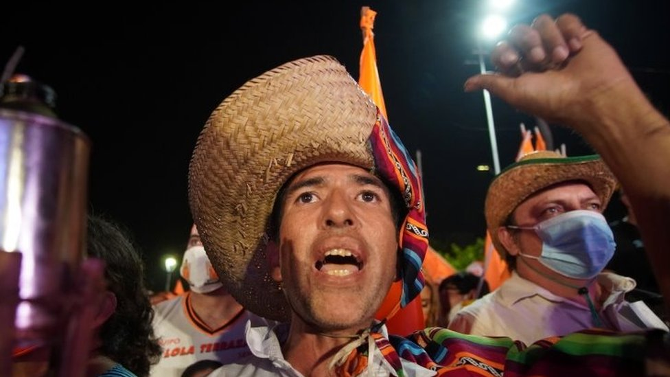 "A supporter of Carlos Mesa, former president and current presidential candidate of the Citizen Community (CC) party, cheers during Mesa""s closing campaign rally ahead of October 18""s general elections, in Santa Cruz, Bolivia October 13, 2020"