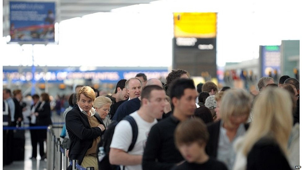 Passengers waiting to check in at Heathrow