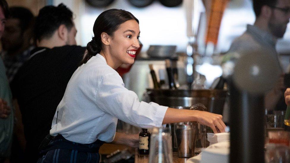 Rep. Alexandria Ocasio-Cortez works behind the bar at the Queensboro Restaurant