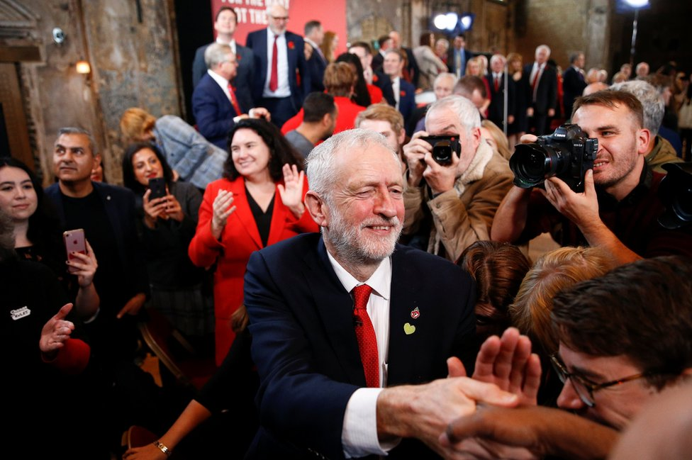 Britain's opposition Labour Party leader Jeremy Corbyn greets supporters