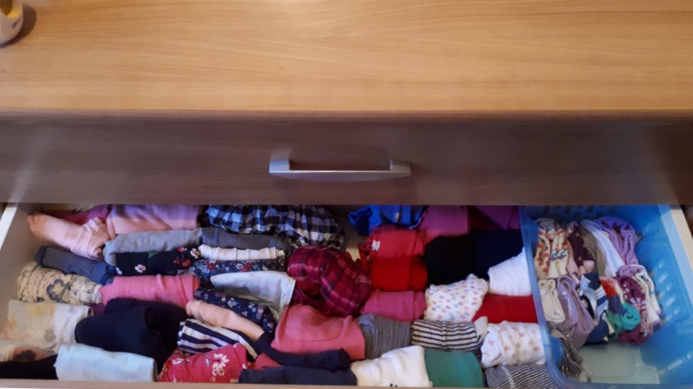 A draw of clothes folded in the Marie Kondo style