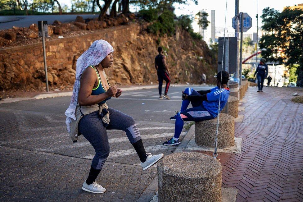 Woman training on the street