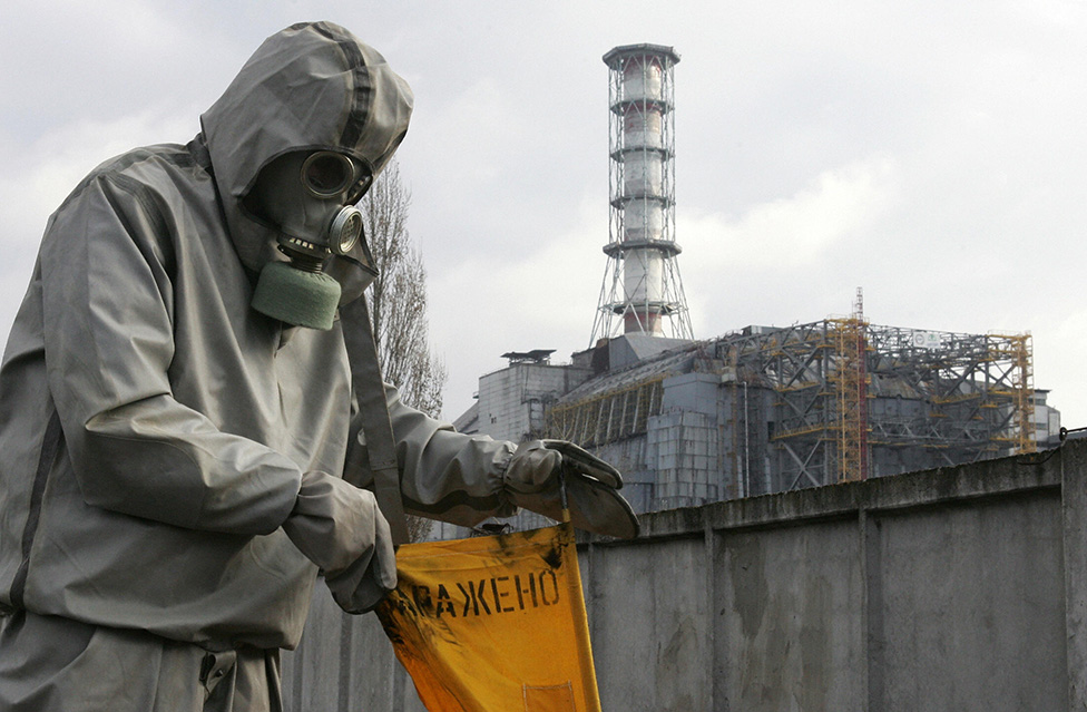 A rescue worker sets flag signalling radioactivity in front of Chernobyl nuclear power plant during a drill organized by Ukraine's Emergency Ministry 08 November 2006.