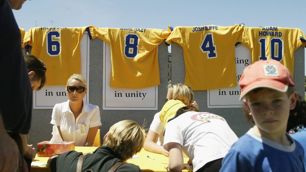 The football jerseys of members of the Coogee Dolphins rugby league killed in the Bali bombings were displayed on 20 October 2002 in Sydney