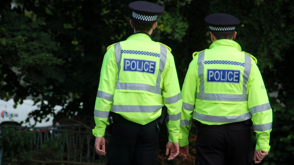Men admit armed robbery at police officers' home in Edinburgh