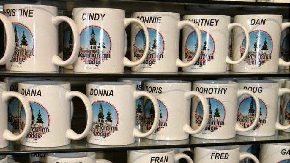Named mugs for sale on a shop shelf