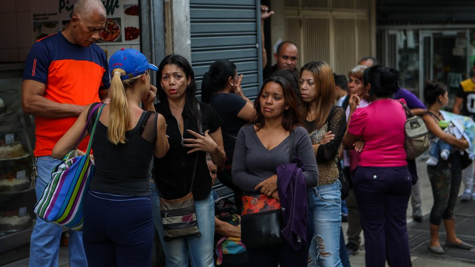 Relatives of victims of the stampede in the El Paraiso club in front of the police headquarters in Caracas, Venezuela, 16 June 2018