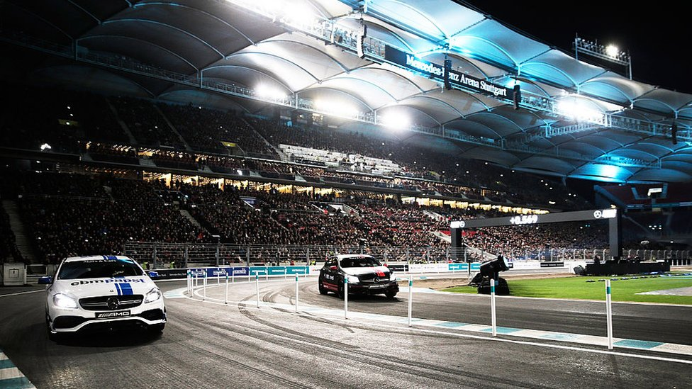 Lewis Hamilton of Great Britain races Mika Hakkinen of Finland in the first round of races in the Mercedes-AMG A 45 of the Stars and Cars event at Mercedes-Benz Arena on 12 Dec 2015 in Stuttgart