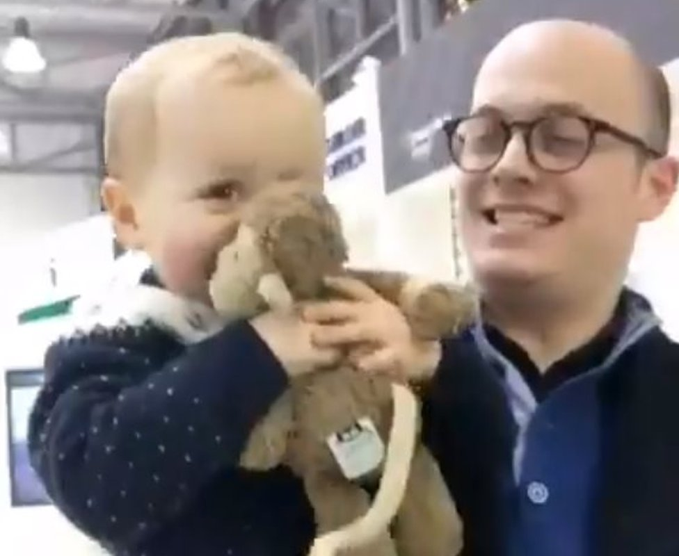 Finn with his father, Keir Regan-Alexander, being reunited with Mac the monkey
