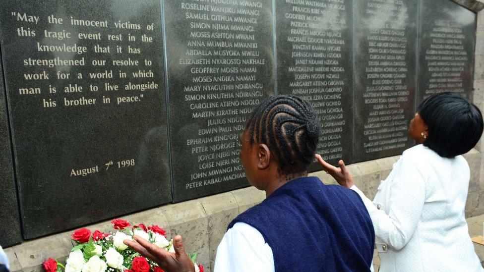 People praying at a amemorial