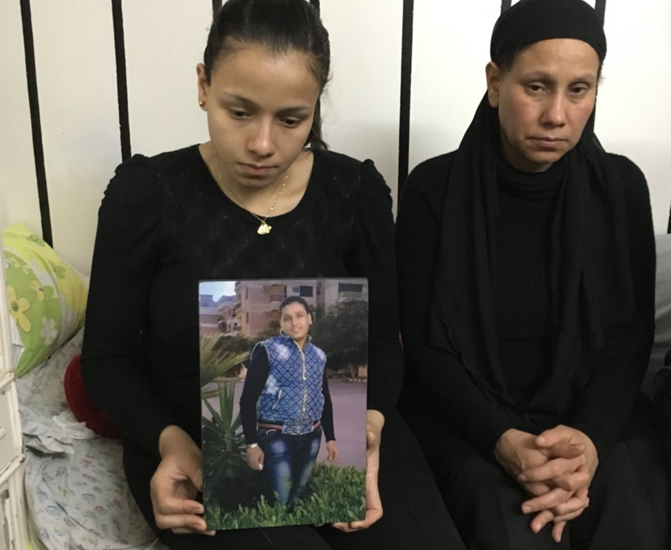 Marian Abdel Malak (left) holds picture of her brother, Bishoy