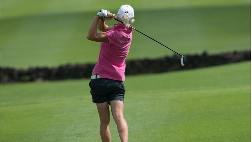 Golfer Melissa Reid of Britain tees off on the final day of the World Celebrity Pro-Am golf tournament at the Mission Hills golf resort in Haikou on the southern Chinese island of Hainan on October 21, 2012
