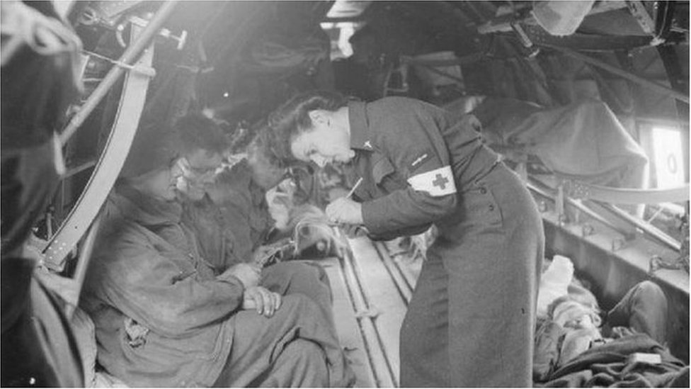A nurse treating soldiers