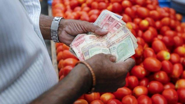 Man counting money at market