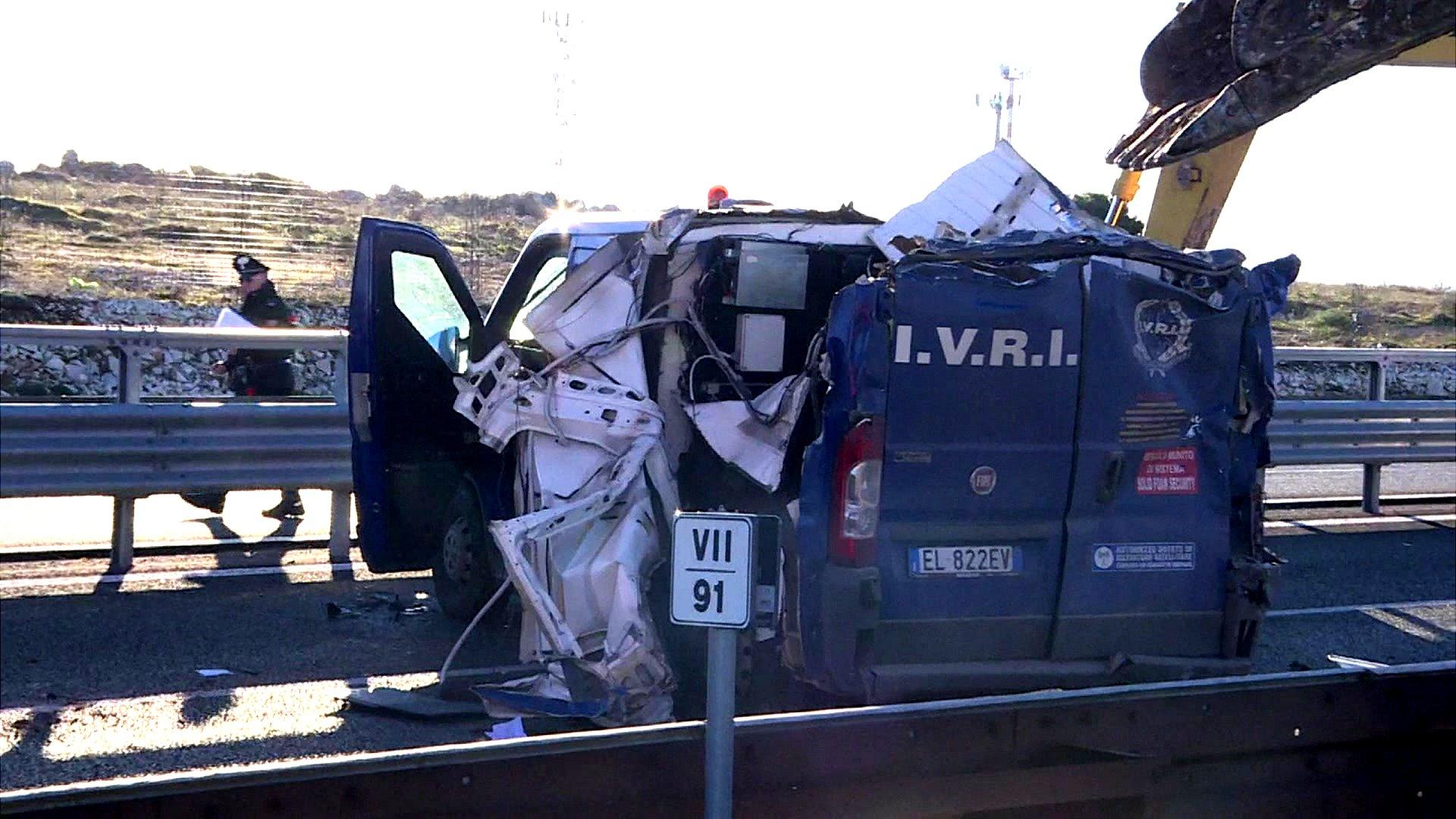 The damaged security van near Bari, southern Italy