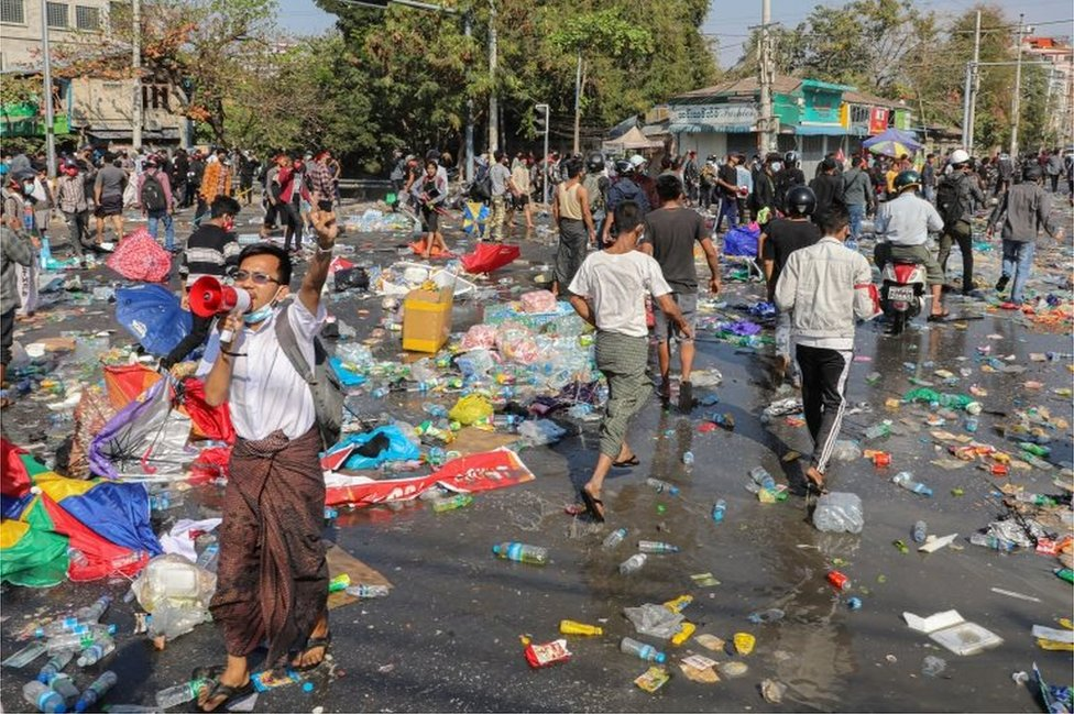 Demonstrators riot against police as they protest against the military coup and to demand the release of elected leader Aung San Suu Kyi, in Mandalay, Myanmar, February 9, 2021.