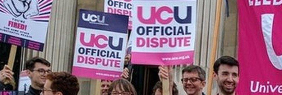 People striking outside a university