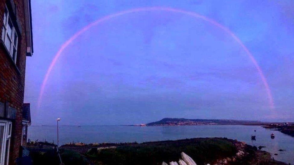 Pink rainbow over Portland, Dorset