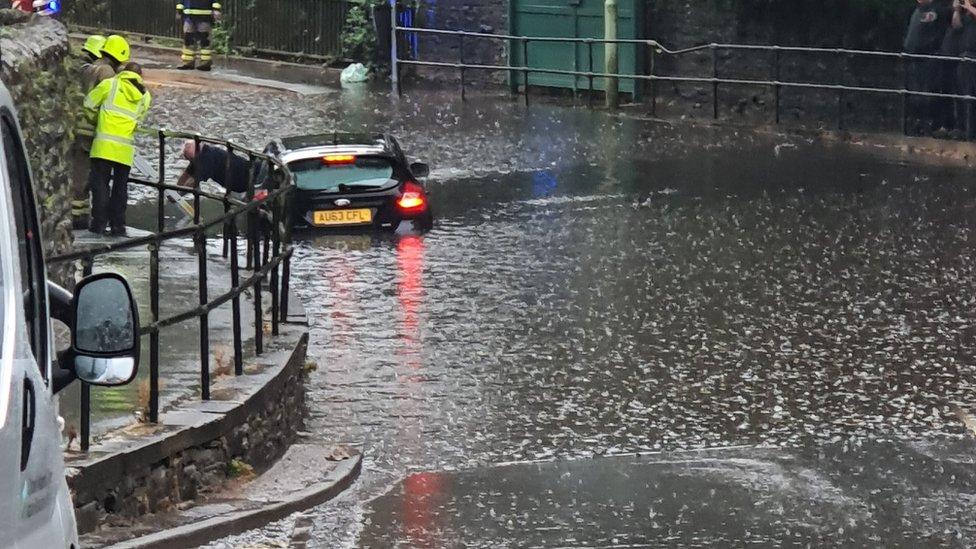 A car stuck under the railway bridge in Aberdare