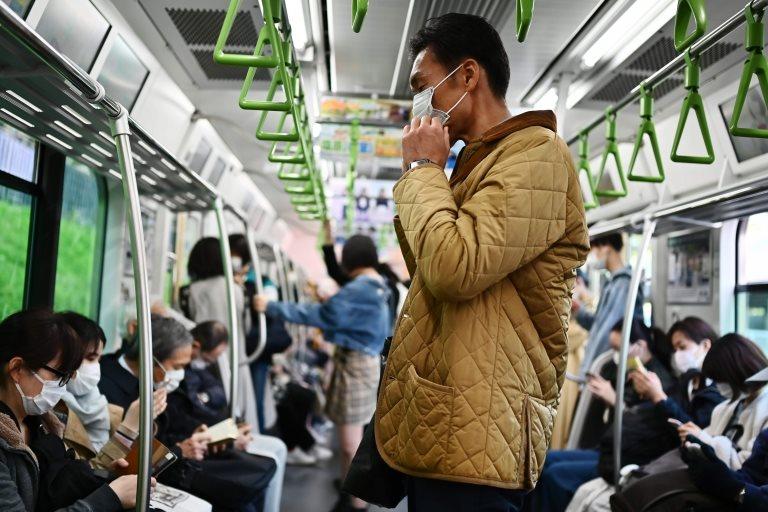 Pasajeros en el metro de Tokio
