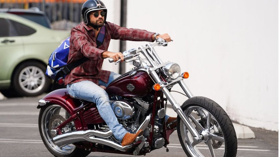Actor Jesse Metcalfe riding a Harley-Davidson