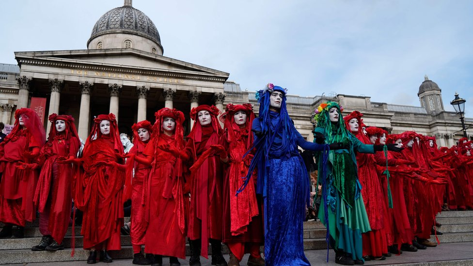 Climate activists protest on the steps of the National Gallery in Trafalgar Square