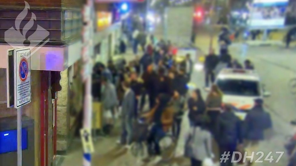 Picture showing people crowded outside Hague restaurant