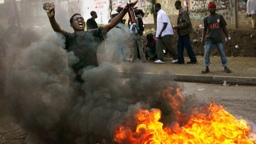 A Kenyan man demonstrates in the Kibera slums on January 17, 2008 in Nairobi, Kenya.