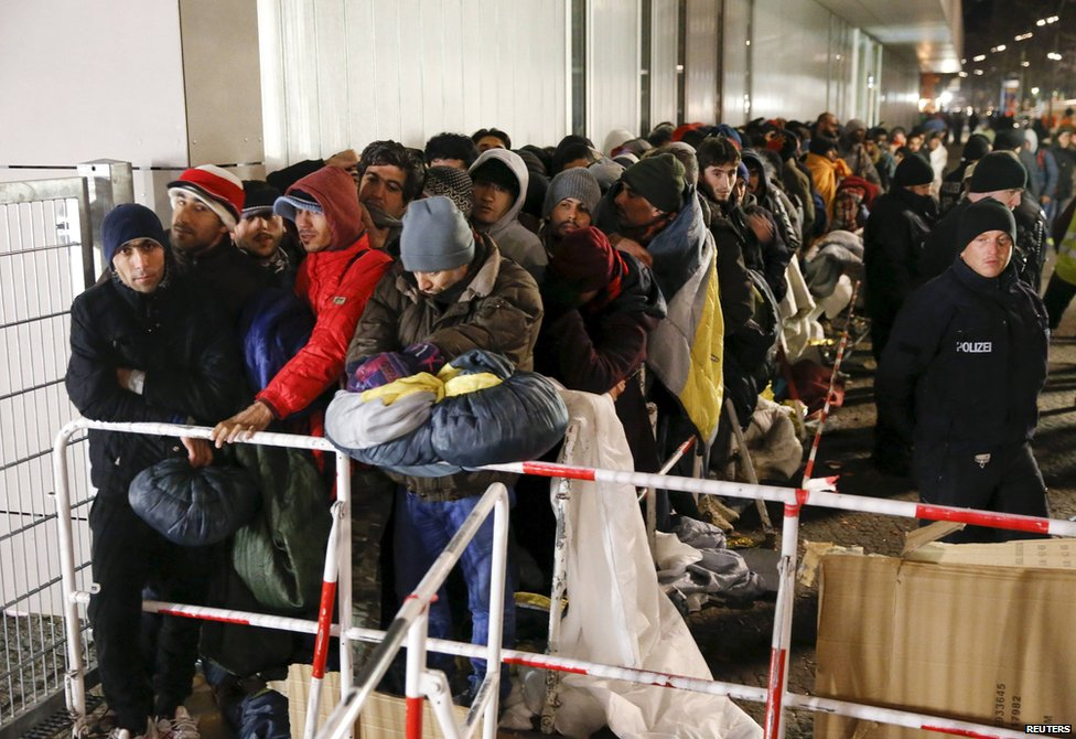 Migrants queue for registration in Berlin, 9 December 2015