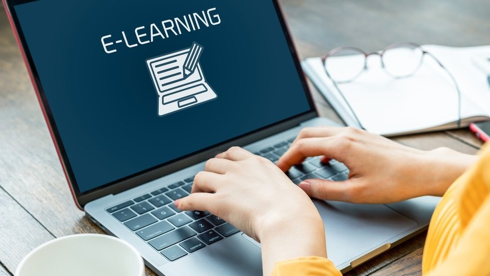 Woman on a laptop with e-learning icon