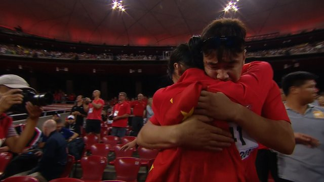 China's Lyu is consoled by her coach