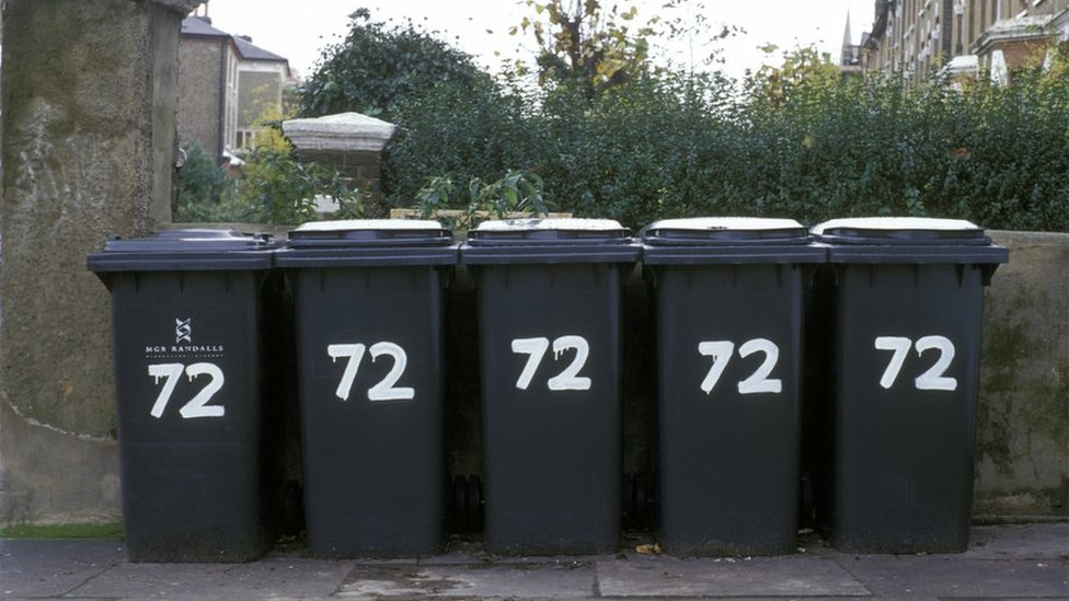 Five wheelie bins all belonging to one property