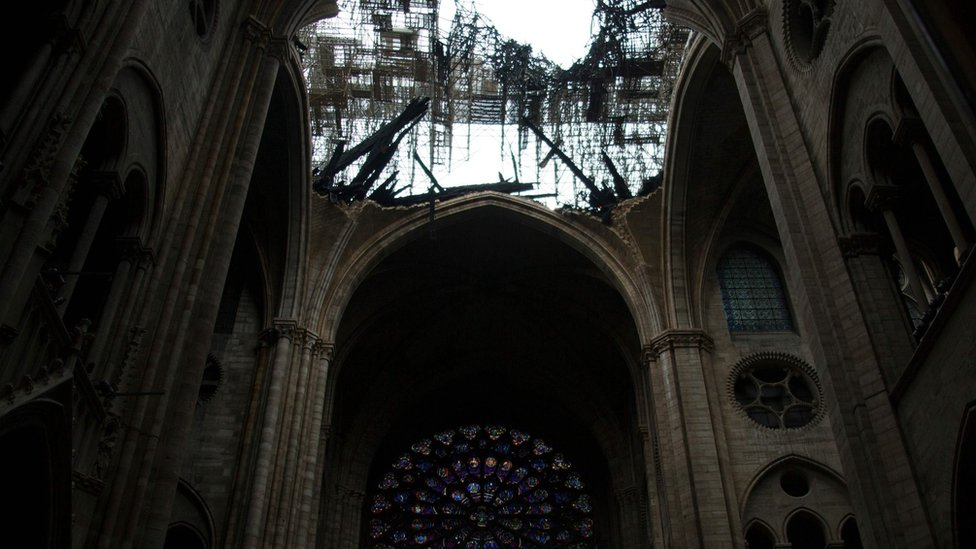 The rose windows below the damaged roof of Notre-Dame-de Paris Cathedral in Paris