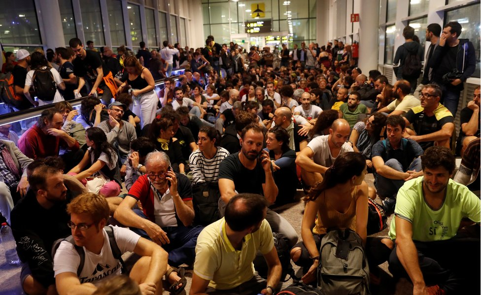 """Thousand of people attend at Barcelona-El Prat international airport to join the rally called by the group called """"Tsunami Democratic"""" (Democratic Tsunami) for """"shutting-down"""" the airport"""