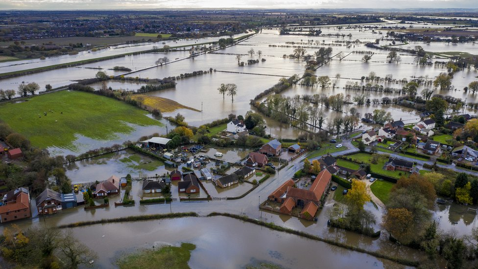 An aerial image of flooding in the village of Fishlake