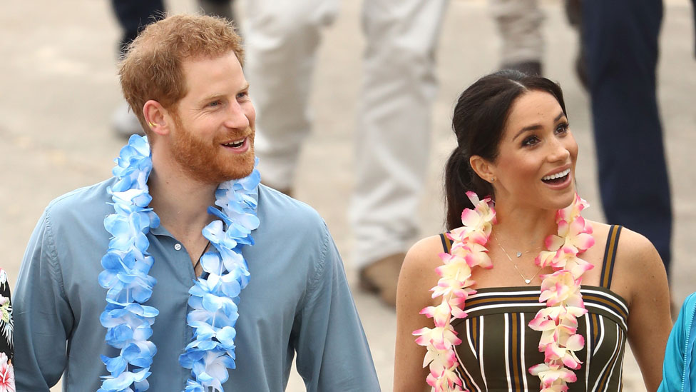 Royal tour: Harry and Meghan kick off their shoes on Bondi Beach