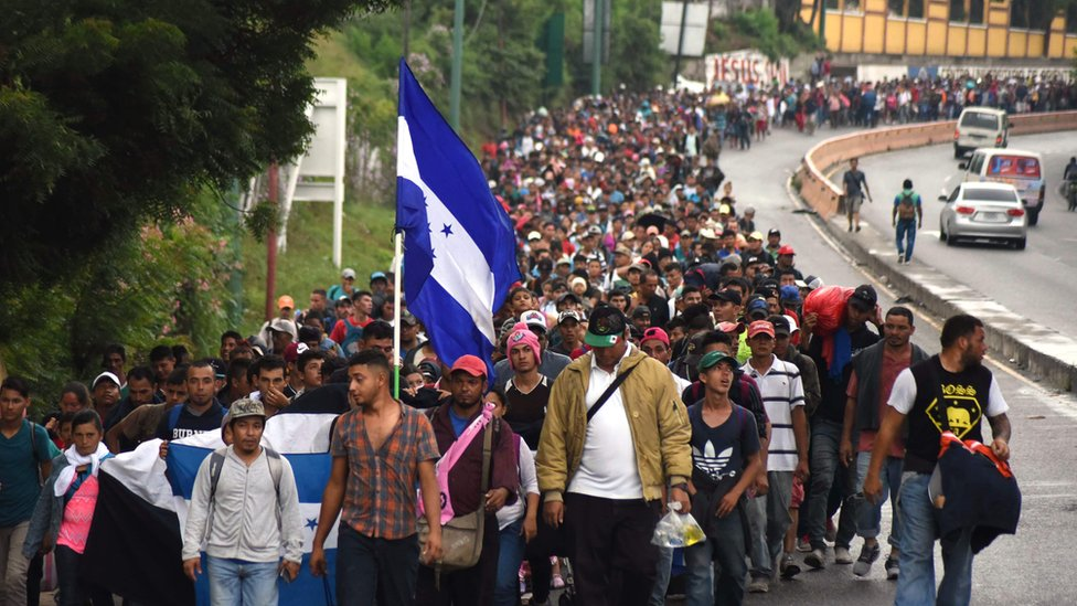 Honduran migrants take part in a caravan towards the United States in Chiquimula, Guatemala on 17 October 2018