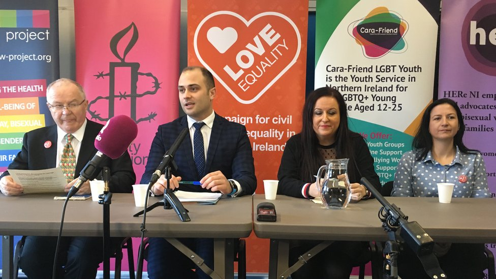 Reverend Chris Hudson, solicitor Ciaran Moynagh and same-sex couple Cara McCann and Amanda McGurk at a press conference about their legal action