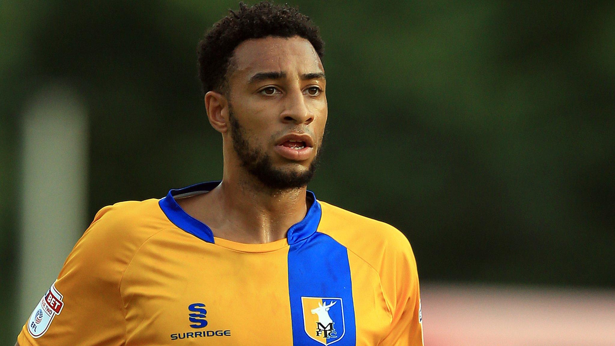 Rhys Bennett: Peterborough United sign Mansfield Town defender