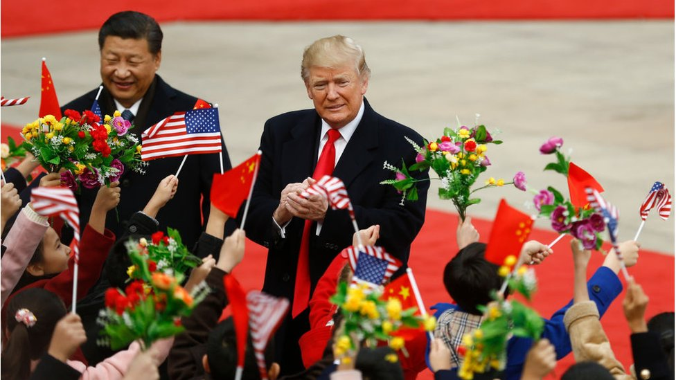 Chinese President Xi Jinping and U.S. President Donald Trump attend a welcoming ceremony November 9, 2017