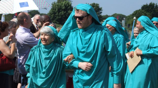 DJ Huw Stephens and actress Elisabeth Miles kitted out in their green robes