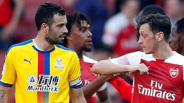 Arsenal's Mesut Ozil and Crystal Palace's Luka Milivojevic talk after Palace's 3-2 win at Emirates Stadium